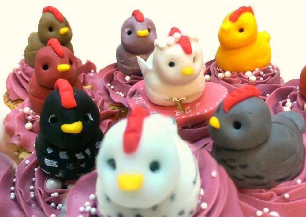 Some of our cute mini hen cake toppers on our delicious red velvet cupcakes